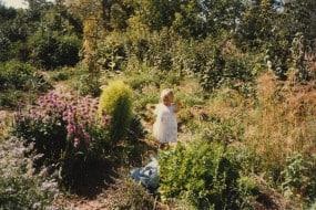 Atina Diffley's daughter Eliza in the garden at Gardens of Eagan in 1985