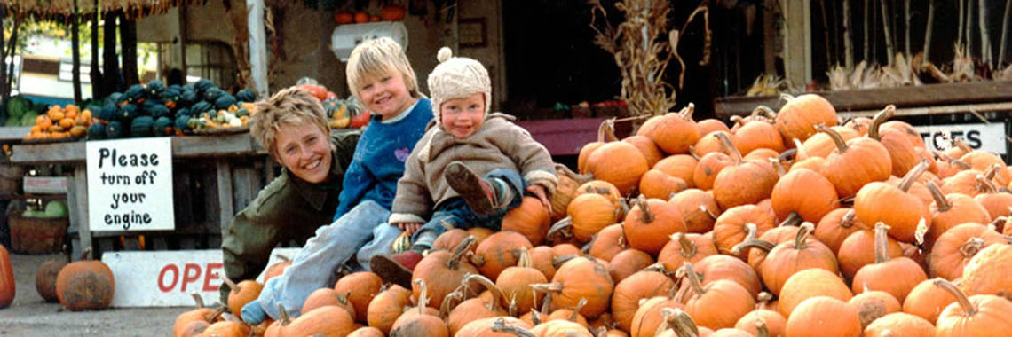 Atina Diffley and her kids at Pumpkin stand at Gardens of Eagan